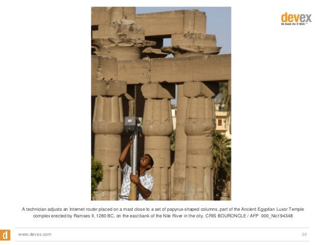 A technician adjusts an Internet router placed on a mast close to a set of papyrus-shaped columns, part of the Ancient Egy...