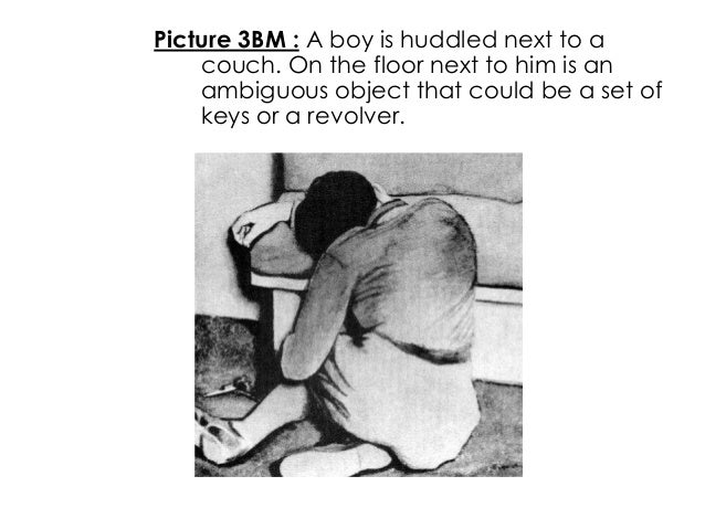 Picture 3BM : A boy is huddled next to acouch. On the floor next to him is anambiguous object that could be a set ofkeys o...