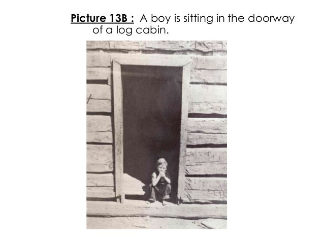 Picture 13B : A boy is sitting in the doorwayof a log cabin.