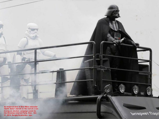 An impersonator of Star Wars character 'Darth Vader' stands on the roof of a van during an election campaign event for the...