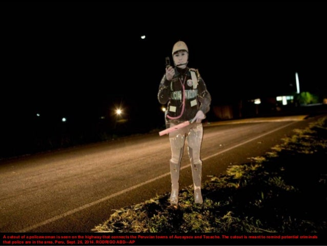 A cutout of a policewoman is seen on the highway that connects the Peruvian towns of Aucayacu and Tocache. The cutout is m...