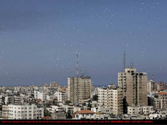 Flyers are dropped over Gaza City by the Israeli army urging residents to evacuate their homes, July 30, 2014. MOHAMMED AB...