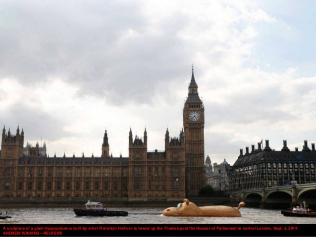 A sculpture of a giant hippopotamus built by artist Florentjin Hofman is towed up the Thames past the Houses of Parliament...