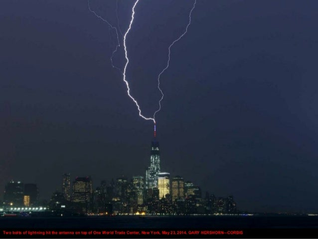 Two bolts of lightning hit the antenna on top of One World Trade Center, New York, May 23, 2014. GARY HERSHORN—CORBIS