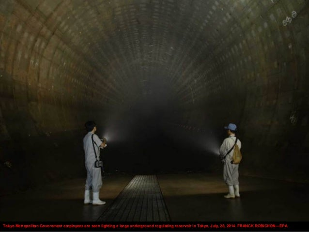 Tokyo Metropolitan Government employees are seen lighting a large underground regulating reservoir in Tokyo, July, 28, 201...