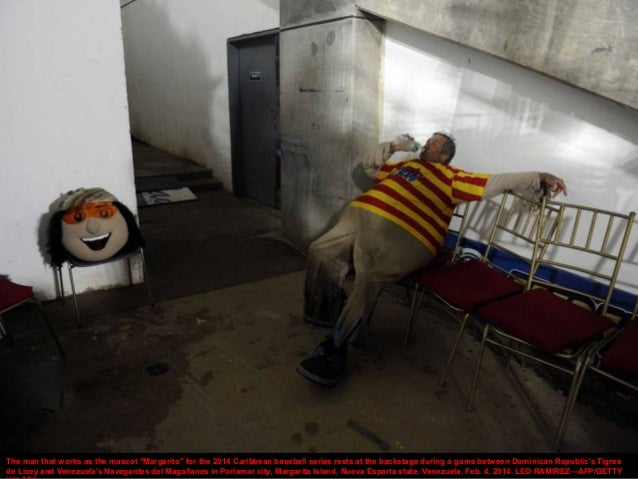 """The man that works as the mascot """"Margarito"""" for the 2014 Caribbean baseball series rests at the backstage during a game b..."""