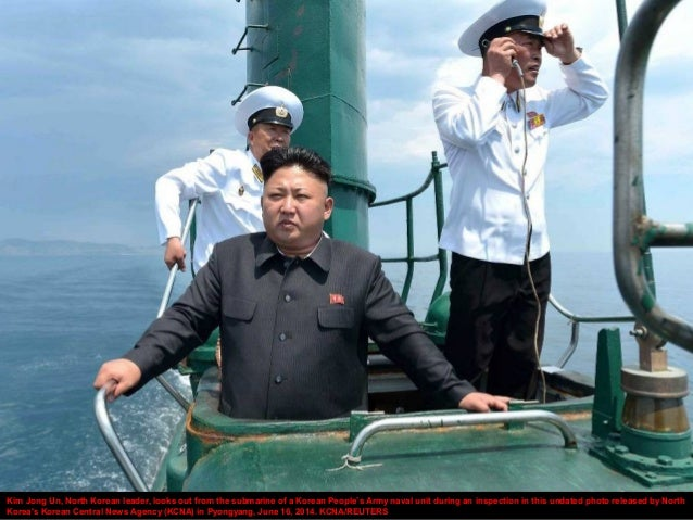 Kim Jong Un, North Korean leader, looks out from the submarine of a Korean People's Army naval unit during an inspection i...