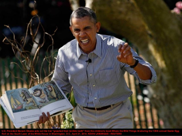 """U.S. President Barack Obama acts out the line """"gnashed their terrible teeth"""" from the children's book Where the Wild Thing..."""