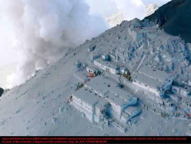 Japan Self-Defense Force (JSDF) soldiers and firefighters conduct rescue operations at mountain lodges covered with volcan...