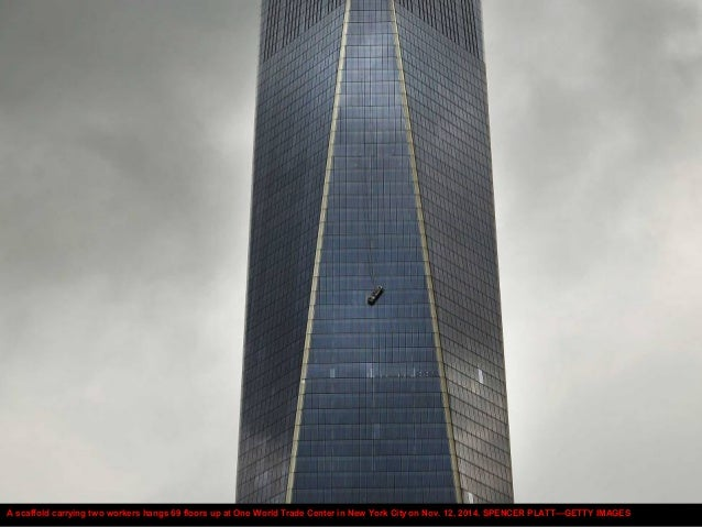 A scaffold carrying two workers hangs 69 floors up at One World Trade Center in New York City on Nov. 12, 2014. SPENCER PL...