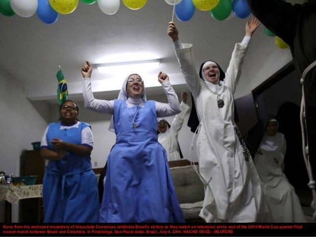 Nuns from the enclosed monastery of Imaculada Conceicao celebrate Brazil's victory as they watch on television at the end ...