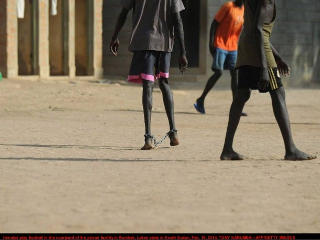 Inmates play football in the courtyard of the prison facility in Rumbek, Lakes state in South Sudan, Feb. 19, 2014. TONY K...
