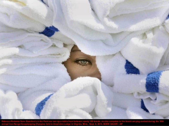 Rebecca Redwine from Grandma's in the Park has one eye visible from between nearly 100 towels, as she competes in the towe...