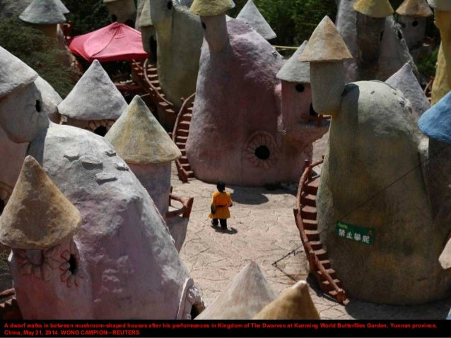 A dwarf walks in between mushroom-shaped houses after his performances in Kingdom of The Dwarves at Kunming World Butterfl...