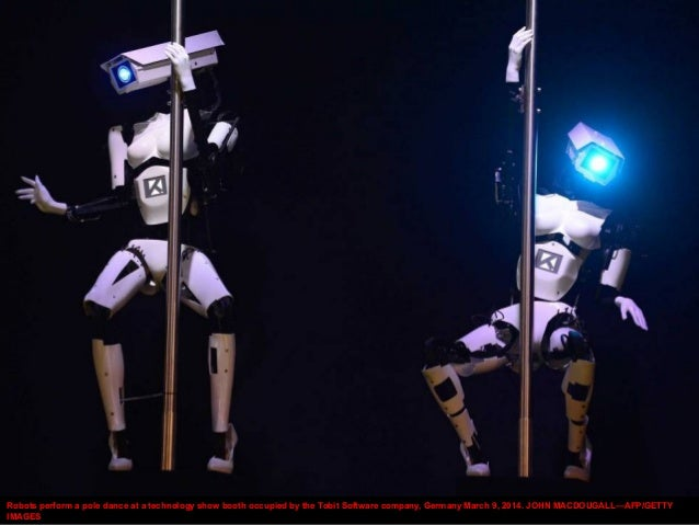 Robots perform a pole dance at a technology show booth occupied by the Tobit Software company, Germany March 9, 2014. JOHN...