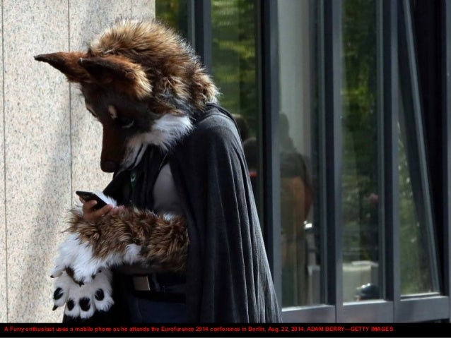 A Furry enthusiast uses a mobile phone as he attends the Eurofurence 2014 conference in Berlin, Aug. 22, 2014. ADAM BERRY—...