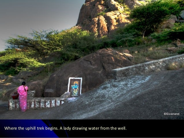Where the uphill trek begins. A lady drawing water from the well.