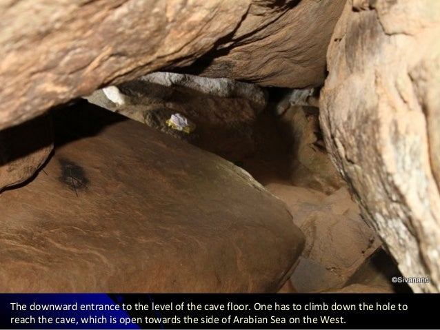 The downward entrance to the level of the cave floor. One has to climb down the hole to reach the cave, which is open towa...