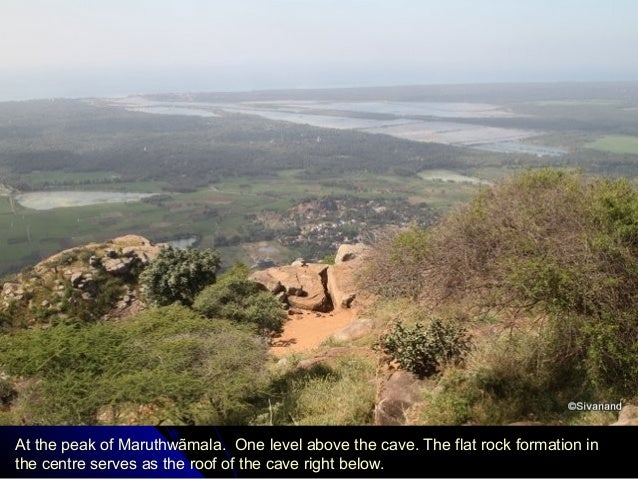 At the peak of Maruthwãmala. One level above the cave. The flat rock formation in the centre serves as the roof of the cav...