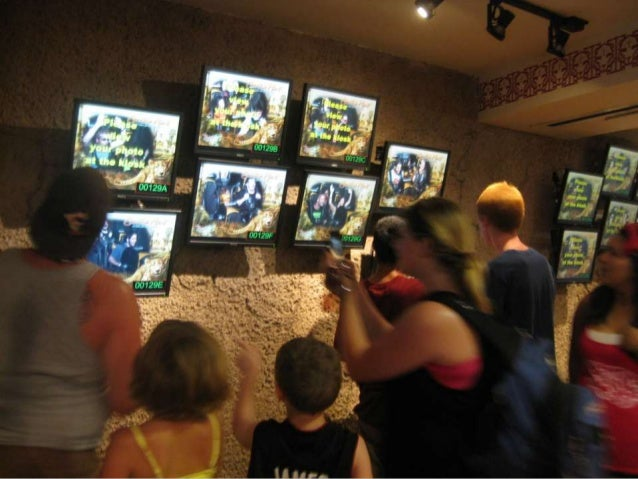  A continuous commotion near the screens: public expressions of excitement  A group of people watching group of screens ...
