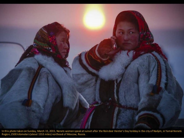 In this photo taken on Sunday, March 15, 2015, Nenets women speak at sunset after the Reindeer Herder's Day holiday in the...