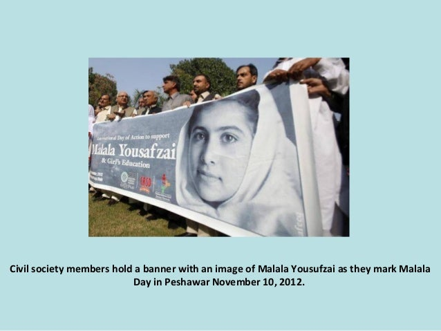 Civil society members hold a banner with an image of Malala Yousufzai as they mark Malala Day in Peshawar November 10, 201...