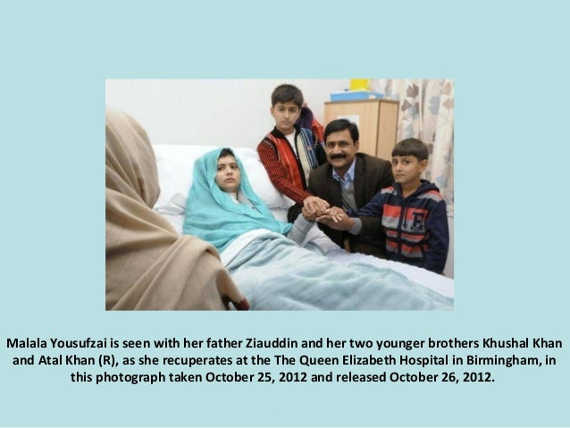Malala Yousufzai is seen with her father Ziauddin and her two younger brothers Khushal Khan and Atal Khan (R), as she recu...
