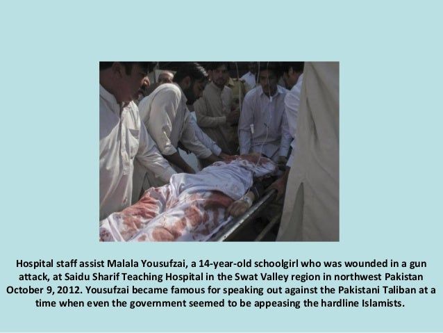 Hospital staff assist Malala Yousufzai, a 14-year-old schoolgirl who was wounded in a gun attack, at Saidu Sharif Teaching...