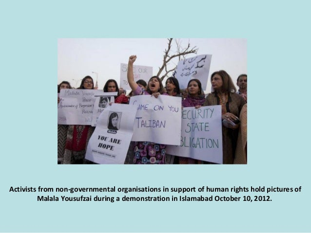 Activists from non-governmental organisations in support of human rights hold pictures of Malala Yousufzai during a demons...