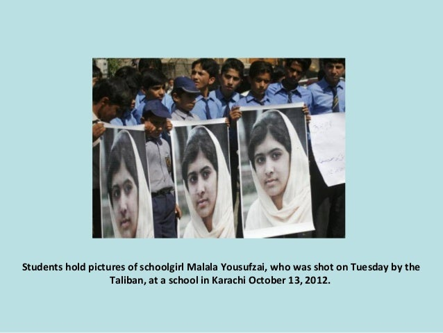 Students hold pictures of schoolgirl Malala Yousufzai, who was shot on Tuesday by the Taliban, at a school in Karachi Octo...
