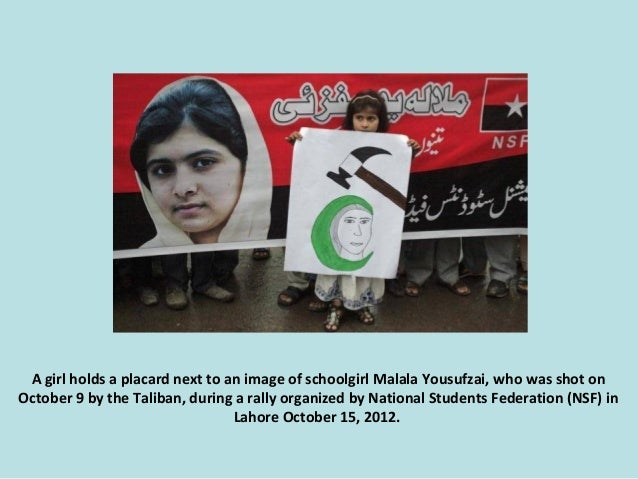 A girl holds a placard next to an image of schoolgirl Malala Yousufzai, who was shot on October 9 by the Taliban, during a...