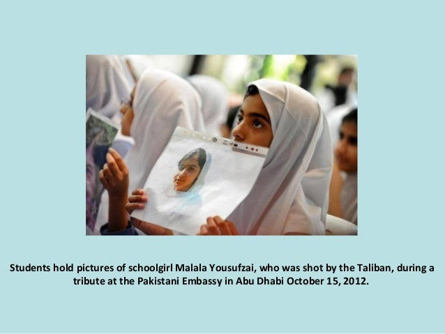Students hold pictures of schoolgirl Malala Yousufzai, who was shot by the Taliban, during a tribute at the Pakistani Emba...