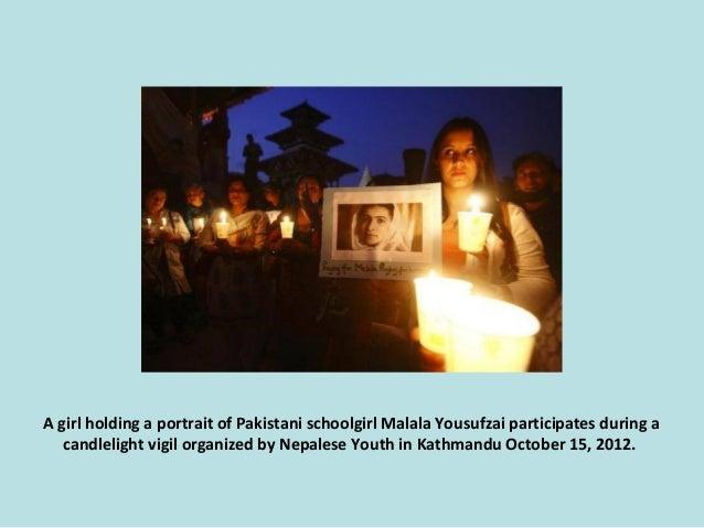 A girl holding a portrait of Pakistani schoolgirl Malala Yousufzai participates during a candlelight vigil organized by Ne...
