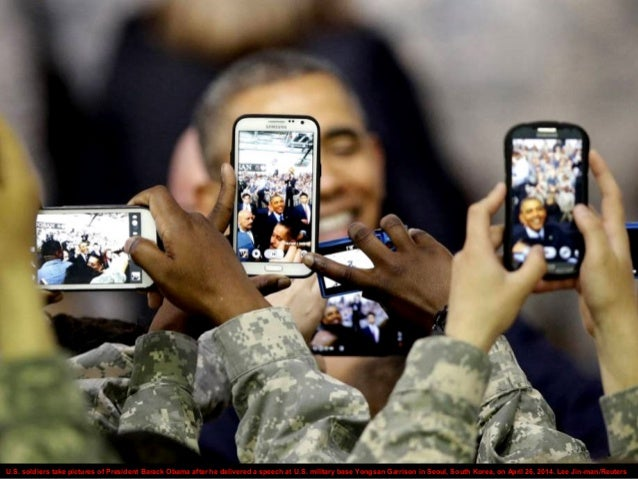U.S. soldiers take pictures of President Barack Obama after he delivered a speech at U.S. military base Yongsan Garrison i...