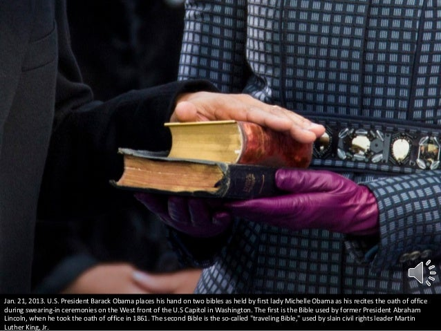 Jan. 21, 2013. U.S. President Barack Obama places his hand on two bibles as held by first lady Michelle Obama as his recit...