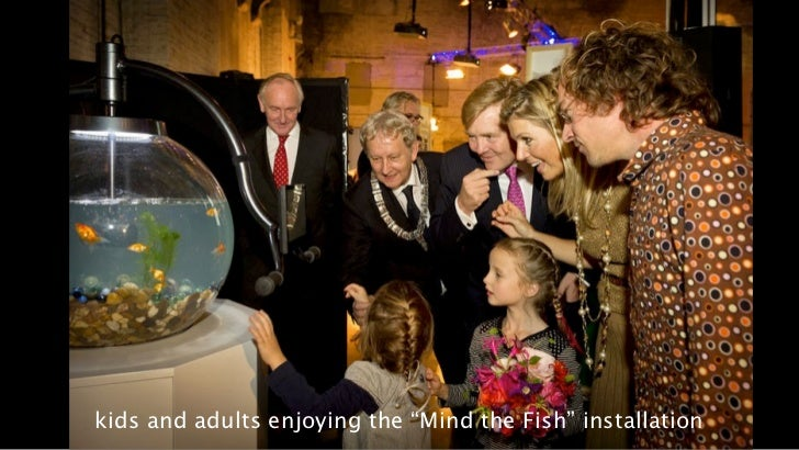 """kids and adults enjoying the """"Mind the Fish"""" installation"""