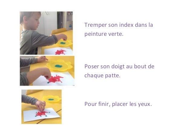 Tremper son index dans la peinture verte.  Poser son doigt au bout de chaque patte.  Pour finir, placer les yeux.