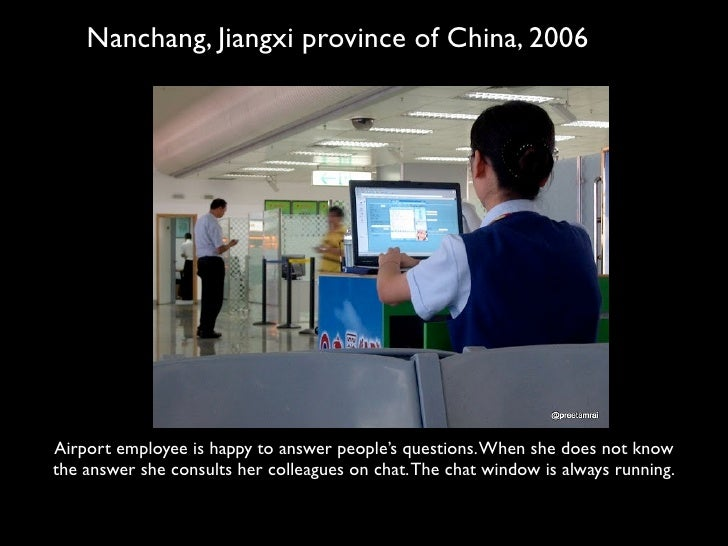 Nanchang, Jiangxi province of China, 2006     Airport employee is happy to answer people's questions. When she does not kn...