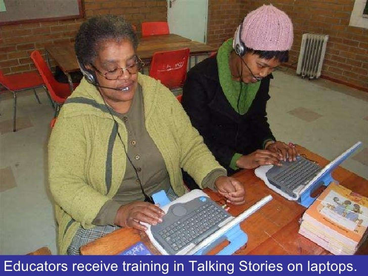 Educators receive training in Talking Stories on laptops.