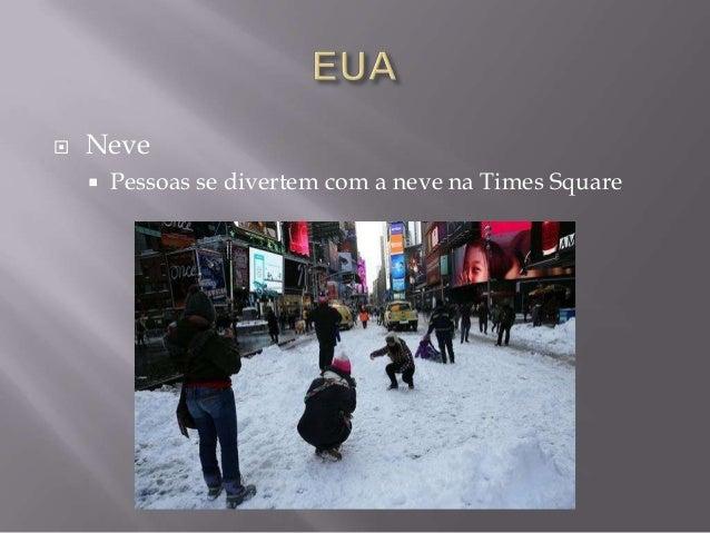   Neve   Pessoas se divertem com a neve na Times Square