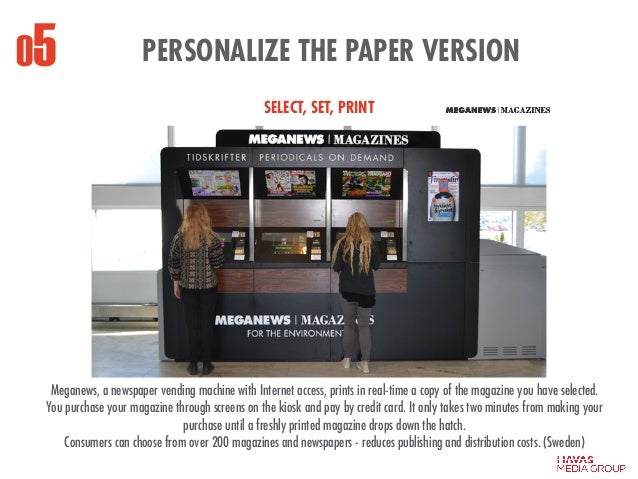 PERSONALIZE THE PAPER VERSION Meganews, a newspaper vending machine with Internet access, prints in real-time a copy of th...