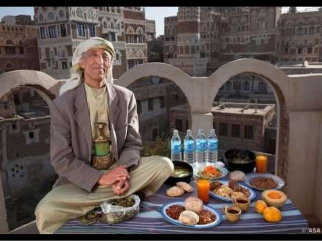 Ahmed Ahmed Swaid, a qat merchant, sits on a rooftop in the old Yemeni city of Sanaa with his typical day's worth of food....