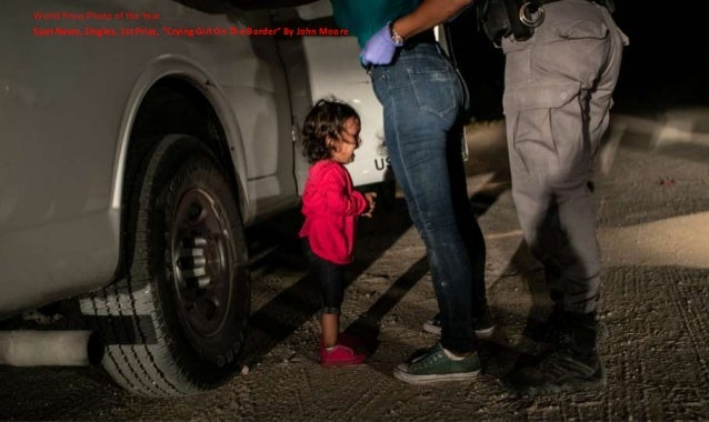 """Spot News, Singles, 1st Prize, """"Crying Girl On The Border"""" By John Moore World Press Photo of the Year"""