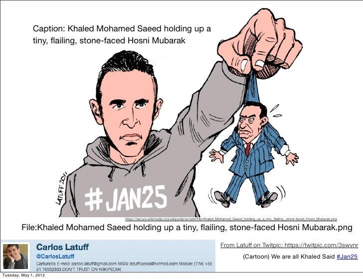 Caption: Khaled Mohamed Saeed holding up a              tiny, flailing, stone-faced Hosni Mubarak                          ...