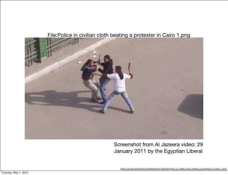 File:Police in civilian cloth beating a protester in Cairo 1.png                                                    Screen...